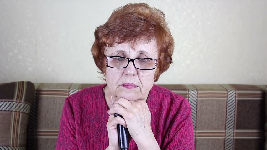 Elderly person wearing glasses