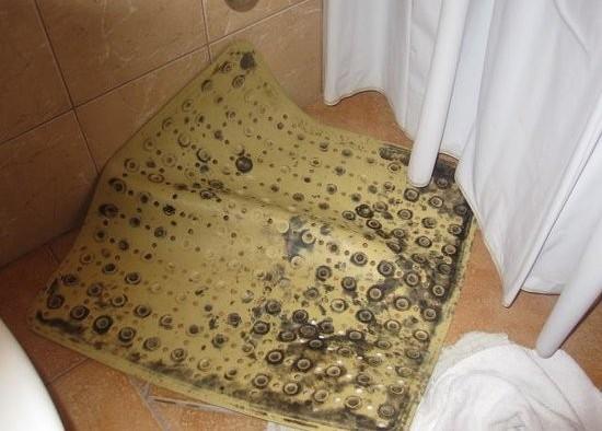 Dirty mouldy rubber bath mat
